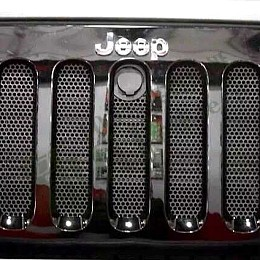Image of a Jeep Wrangler Angry Grilles 3D Grille mesh Black Color fits OEM Grille