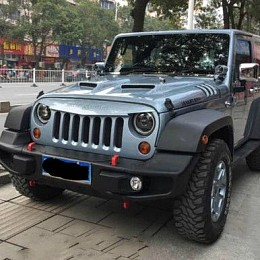 Image of a Jeep Wrangler 10th Anniversary Style Front Winch Bull Bar with corners