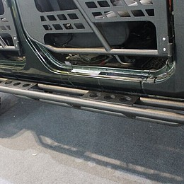 Image of a Jeep Wrangler Rock Sliders 4 Door 3 tube rock sliders Running Board Side Steps