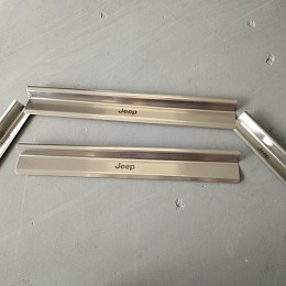 Image of a Jeep Wrangler 4 door Stainless Steel door sill plate door panel add on (without Logo)