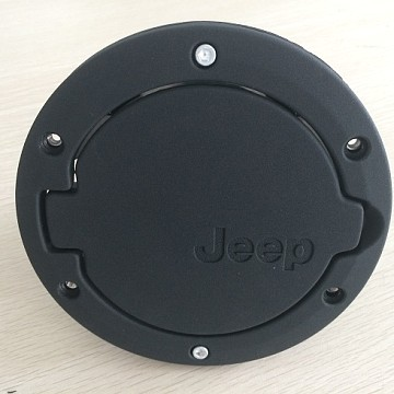 Image of a Jeep Wrangler  Accessories Black Fuel Cap Door Cover With Jeep Logo