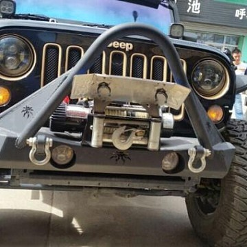 Image of a Jeep Wrangler Body Armor JW0329 Poison Spyder Style Steel Front Winch Bull Bar