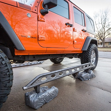 Image of a Jeep Wrangler Rock Sliders PS Style Rock Slider for 4-Door Jeep Wrangler JK Black-satin (Set)