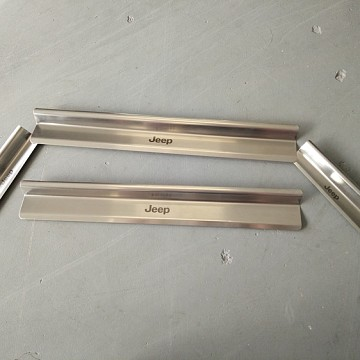 Image of a Jeep Wrangler  4 door Stainless Steel door sill plate door panel add on
