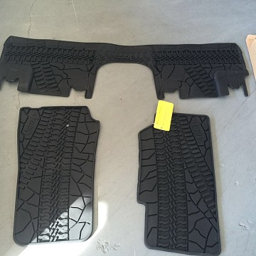 Image of a Jeep Wrangler Interior 4 door Jeep Style Black Rubber Floor Mat Front and rear