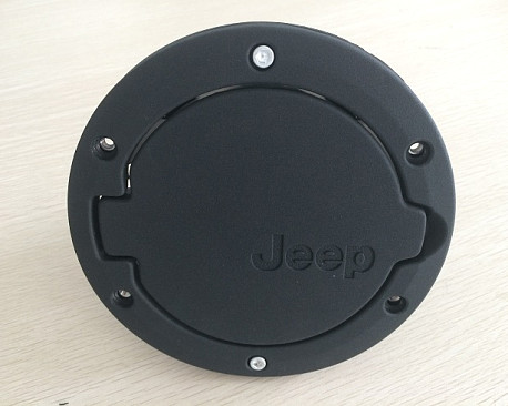 Picture of a Black Fuel Cap Door Cover With Jeep Logo