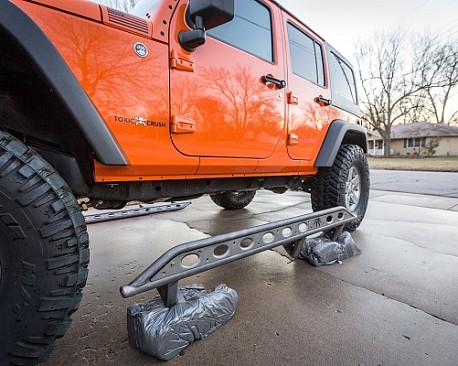 Picture of a Poison Spyder Style Rock Slider for 4-Door Jeep Wrangler JK Black-satin (Set)