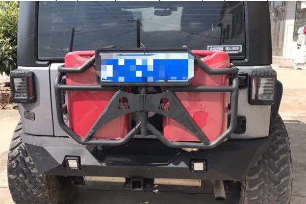 Picture of a Jeep Wrangler JK Jerry Can holder with 2 Jerry Cans